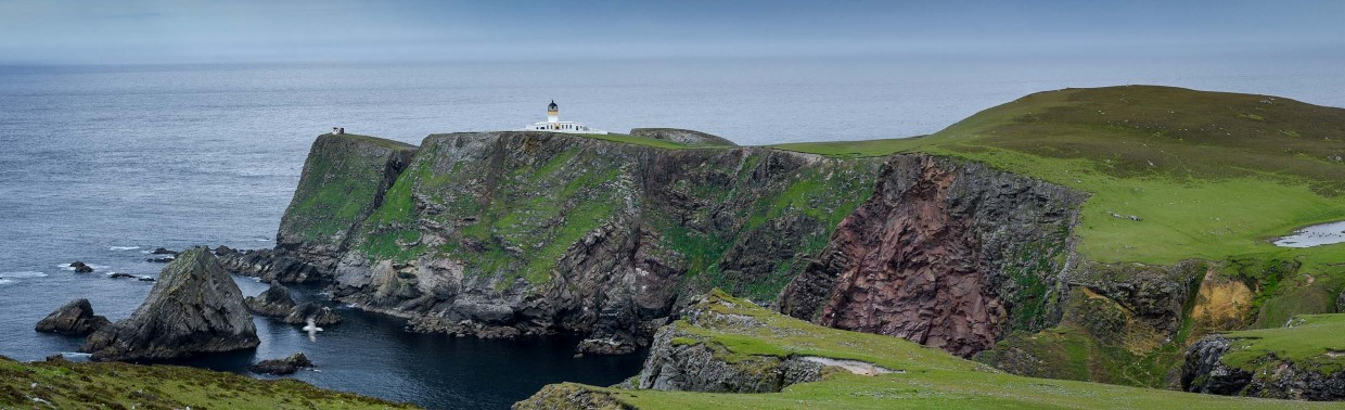 Cliffs, sea and a green landscape attract visitors to Fair Isle.