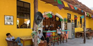 Visit one of the cafes and restaurants in this lively island town.
