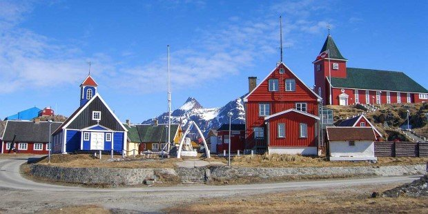 Idyllic Sisimiut with wooden church and colourful houses.