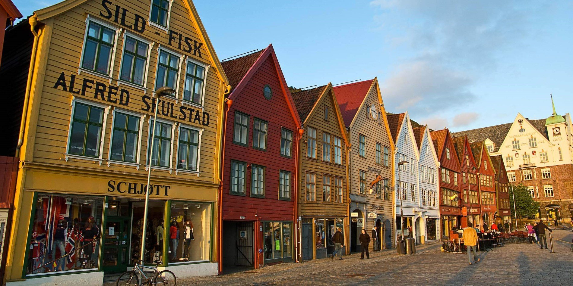 A group of people walking in front of Bryggen