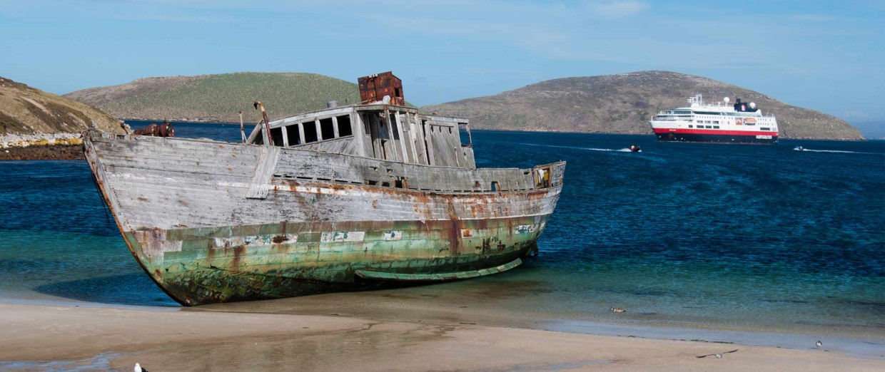 A shipwreck in the Falkand Islands with MS Fram in the background