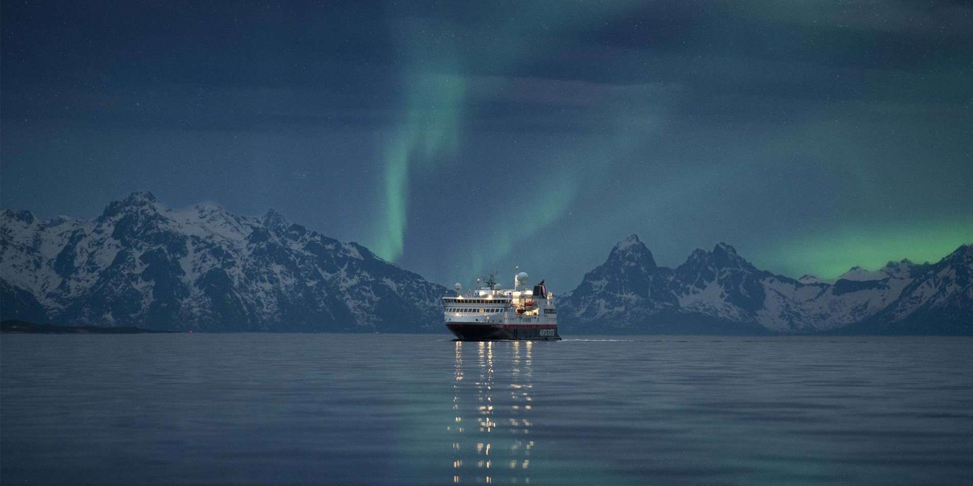 MS Spitsbergen under the Northern Lights in Norway