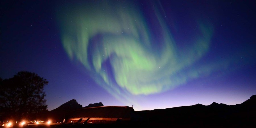 The northern lights over Lofotr Viking Museum