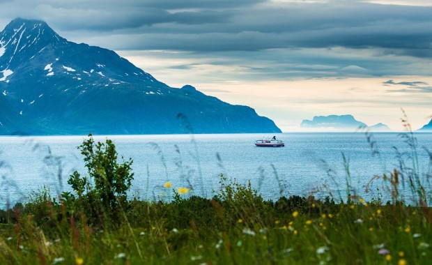 Sailing through Lyngenfjord, pure Arctic wilderness.