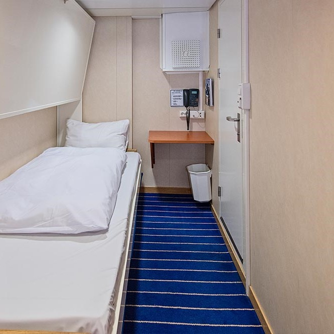 A bed in a small room