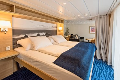 The refurbished cabins on MS Spitsbergen offer relaxation in a comfortable and modern interior.